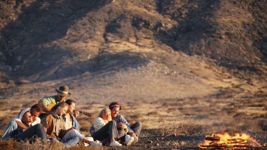 Group sitting on campfire