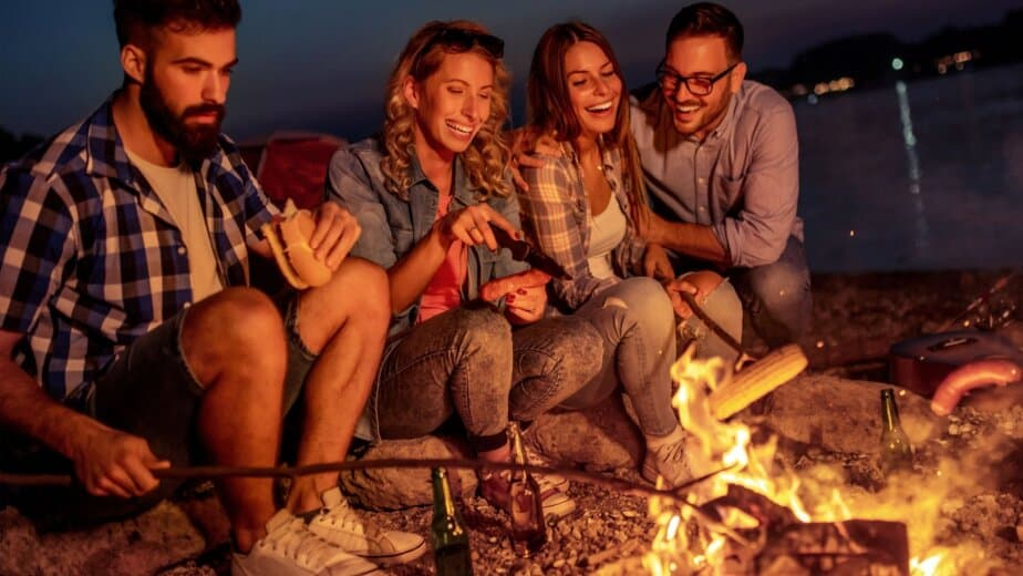 Group sitting on camping fire